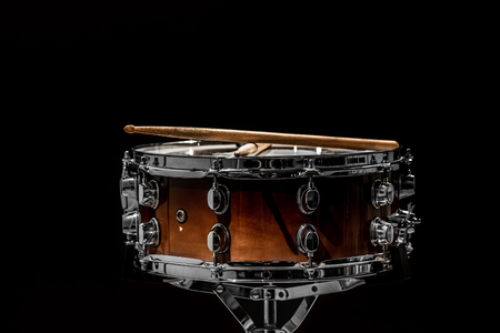 marching band: snare on a black background, musical instrument, musical concept