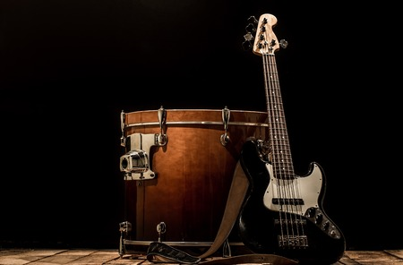 cymbol: musical instruments, drum bass Bochka bass guitar on a black background, the music concept