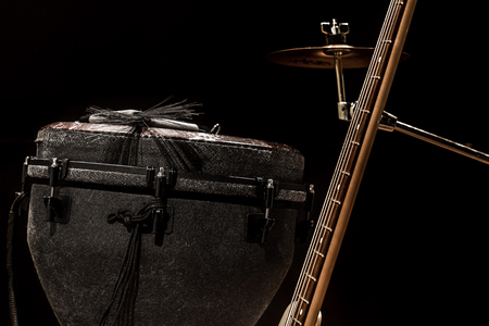 drumsticks: musical instruments, acoustic guitar and bass guitar and percussion instruments drums on a black background, the music concept Stock Photo