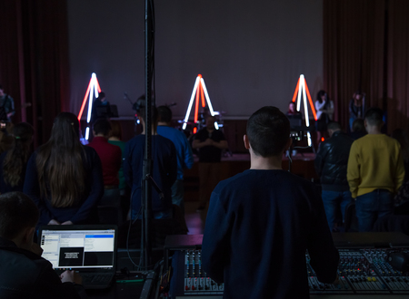 lighting background: the job of a sound technician at the concert, the musical concept