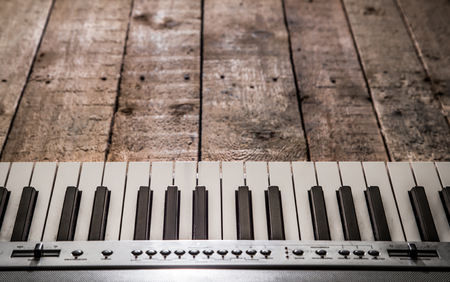 piano on wooden background closeup ,concept musical instruments