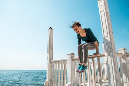 sporty girl on the pier doing exercises to do fitness ,sports motivation,sports,healthy lifestyle Stock Photo