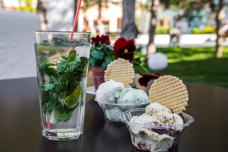 ice cream in cups and drink Mojitos on a wooden table,concept restaurants and cafes Banco de Imagens