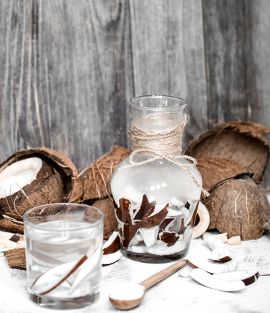 infused: Summer coconut drink, on a wooden background, the concept of refreshing drinks