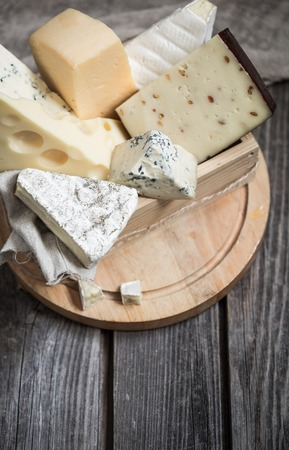 roquefort: arrangement of gourmet cheese on wooden background,concept of gourmet cheeses
