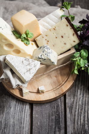 arrangement of gourmet cheese on wooden background,concept of gourmet cheeses Stock fotó - 80103143