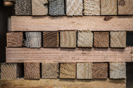 wooden floors: beautiful background with folded strips of wood, close-up Stock Photo