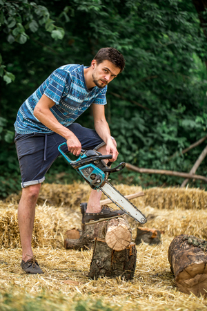 Man chopping wood with a chainsaw Stock Photo