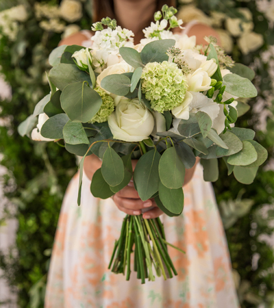 fiancee: A beautiful bouquet in the girls hands ,close-up ,holiday concept