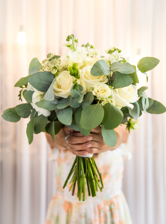 A beautiful bouquet in the girls hands ,close-up ,holiday concept