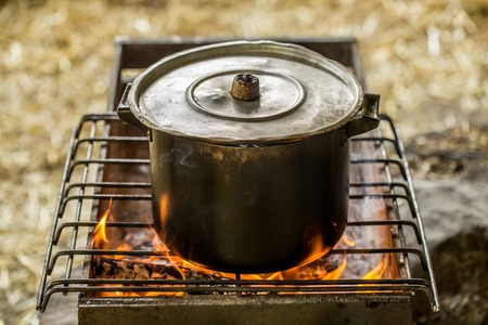Saucepan on the fire ,the concept of camping and recreation
