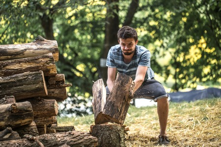 Man chopping wood with an axe ,close-up