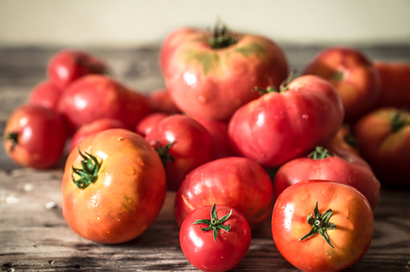 Ripe tomatoes on wooden background ,concept farm vegetables and healthy eating