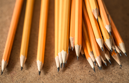 assembled: a variety of graphite pencils on wooden background,closeup Stock Photo