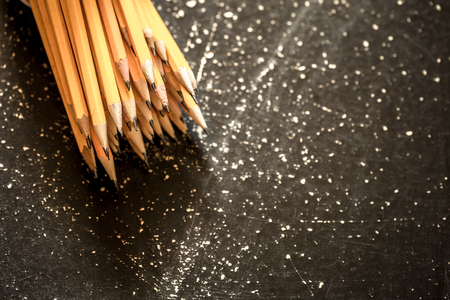 erased: a variety of graphite pencils on wooden background,closeup Stock Photo