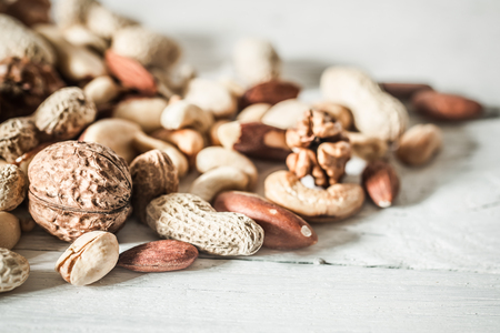 different nuts closeup on wooden background ,concept of healthy nutrition Stock Photo