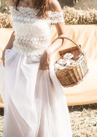 flowergirl: the bride with a basket in her hands ,holiday concept and the wedding