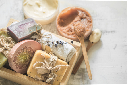oddity: Natural soap Spa set in wooden box place for text on white background, concept of body care and healing Stock Photo
