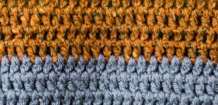 multi-colored knitted cosy texture closeup background,the concept of diversity