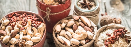 different nuts in a plate closeup ,concept of healthy nutrition Stock Photo