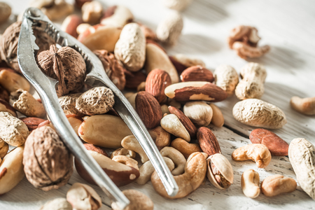 different nuts with recodable closeup ,concept of healthy nutrition
