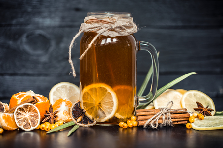 composition lemon tea in a transparent glass with a handle ,the concept of hot drinks and health