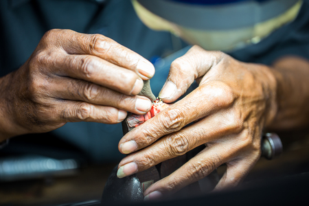 art processing: Thai jeweler, handles the jewelry and precious stones in the workshop, the process of jewelry making ,close-up