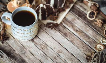 a cozy Cup of tea and piece of cake on wooden background,concept of holidays and tea parties