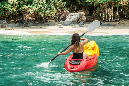 girl on canoe concept of travel and hobby Stock Photo