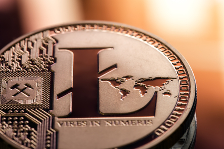 Coin litecoin closeup on a beautiful background. Conceptual image of a digital cryptocurrency and payment system, a coin with the image of the letter L