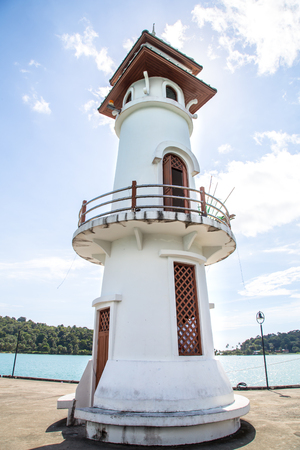 White lighthouse on the pier, beautiful building, view from below