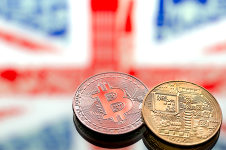coins Bitcoin, on a background of Great Britain and the British flag, concept of virtual money, close-up. Conceptual image of digital crypto currency. 版權商用圖片