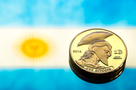 coins Bitcoin, against the background of Argentina flag, concept of virtual money, close-up. Conceptual image of digital crypto currency. Stock Photo