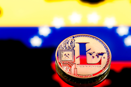 coins litecoin, amid Colombia flag, concept of virtual money, close-up. Conceptual image of digital crypto currency. Stock Photo