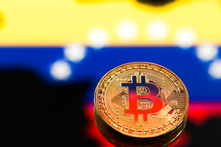 coins Bitcoin, amid Colombia flag, concept of virtual money, close-up. Conceptual image of digital crypto currency.