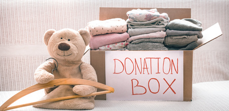 Box with clothes for charity, concept of social projects Stockfoto