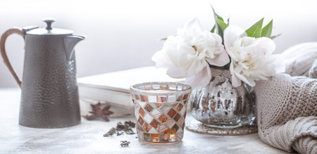 tea ceremony, tea in a beautiful glass with a teapot and flowers in the background