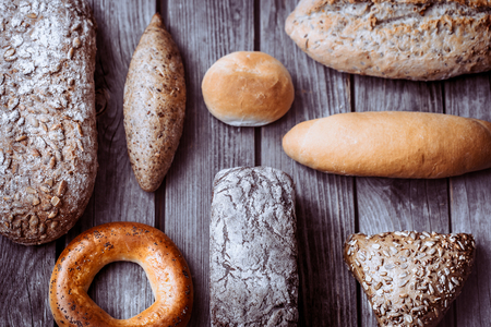 diverse fresh bread on a beautiful wooden background, concept of healthy eating and baking industry