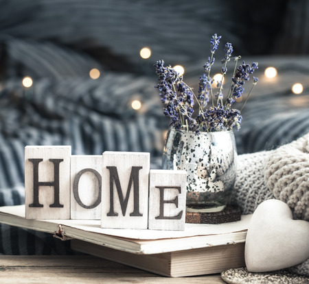 home decorations in the interior of a letter with an inscription home on a wooden background in the interior of the bedroom Standard-Bild