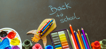Back to school, school supplies on a black background, the concept of education and school life