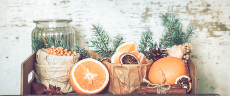 Still life with orange and sea buckthorn on a wooden background, concept of seasonal vitamins and healthy eating.