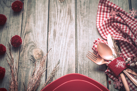 Christmas dinner with beautiful cutlery and festive decorations on wooden background, celebration concept and homely atmosphere