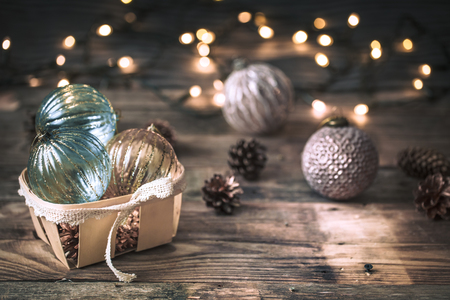 Christmas or New Year festive background, vintage toys on the Christmas tree on a wooden background with a garland with lights Stock Photo