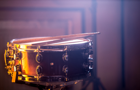 snare drum with sticks on a beautiful colored background, the concept of musical instruments