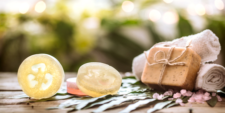 Spa handmade soap and a towel, the composition of the tropical leaves wooden background with space for text, concept of Spa and relaxation for the body Imagens