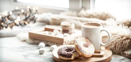 morning breakfast with delicious donuts and coffee at home by the window Foto de archivo