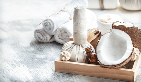 Spa still life with fresh coconut and body care products on light background, spa therapy concept Imagens