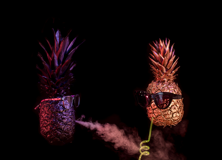 club concept ,black and gold pineapples in sunglasses, drink cocktail with straw and smoke hookah on black isolated background, Studio shooting, creative and art 写真素材