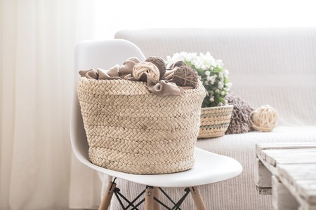 still life in the living room with white chair and home decor , the concept of home comfort