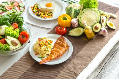 Organic healthy food at the light dining table in a homely atmosphere. The concept of healthy eating and home-cooked food